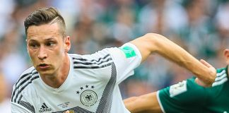 Julian Draxler, fonte By Дмитрий Садовников - https://www.soccer.ru/galery/1054013/photo/730793, CC BY-SA 3.0, https://commons.wikimedia.org/w/index.php?curid=70023204
